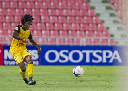 premier league: BANGKOKTHAILAND:JUNE 2015:MFAnthony Komenan No.11 Osotspa F.C yellow.vs Bangkok Glass F.C.blackat Rajamangala National StadiuminThai Premier League on 27 june2015Bangkok Thailand.