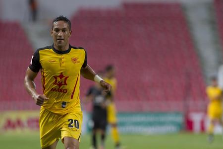 premier league: BANGKOKTHAILAND:JUNE 2015:FWAddison Alves No.20 Osotspa F.C yellow.vs Bangkok Glass F.C.blackat Rajamangala National StadiuminThai Premier League on 27 june2015Bangkok Thailand.