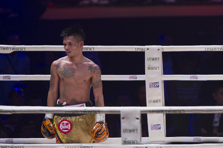 riel: BANGKOK,THAILAND:JUNE 2015:John Riel Reponte Casimero;Amnat Ruenroeng Championship IBF Thailand vs John Riel Reponte Casimero  Challenger Philippines at Hua Mark Indoor Stadium on 27 june2015,Bangkok Thailand. Editorial