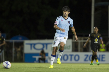 tot: BANGKOK,THAILAND:AUGUST;2015:Takahiro Kawamura of TOT SC poses during football Thai Premier League between TOT SC and Osotspa M-150 Samutprakan FC at TOT Stadium on AUGUST 8,2015inThailand.