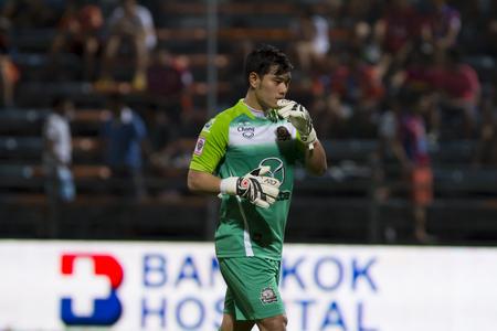 premier league: BANGKOK,THAILAND:JUNE 2015:GK,Kampon No.1 Thai;PORT F.C.OBvs Nakhon Ratchasima Mazda F.C.Wat PAT Stadium;inThai Premier League on15July2015,Bangkok Thailand. Editorial