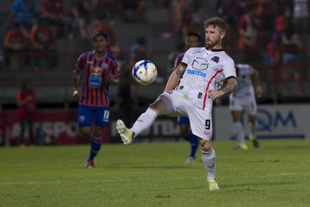 premier league: BANGKOK,THAILAND:JUNE 2015:FW,Lee Tuck No.9U.K.;PORT F.C.OBvs Nakhon Ratchasima Mazda F.C.Wat PAT Stadium;inThai Premier League on15July2015,Bangkok Thailand. Editorial