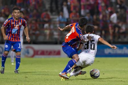 pat: BANGKOK,THAILAND:JUNE 2015:Salawut No.36 extraction clearance;PORT F.C.OBvs Nakhon Ratchasima Mazda F.C.Wat PAT Stadium;inThai Premier League on15July2015,Bangkok Thailand. Editorial