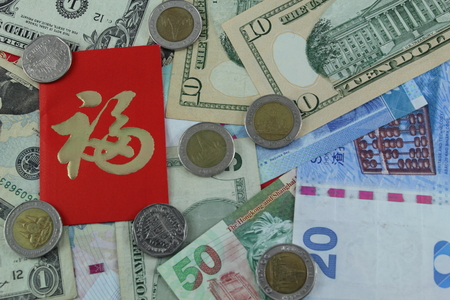 pao: Ang Pao envelope and money in the Chinese New Year. Stock Photo