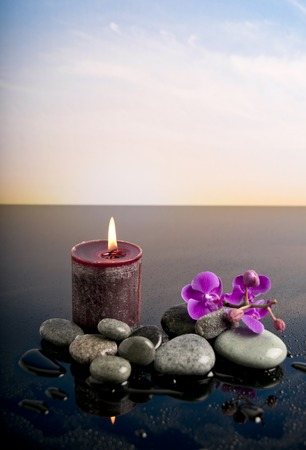 fire flower: Spa sitting with candle, stone and flower