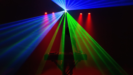 Disc jockey, DJ, silhouette with laser light. Front view Stock Photo