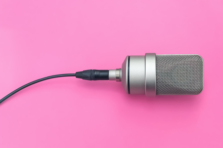 Mic, professional diaphragm microphone. Pink background Stock Photo