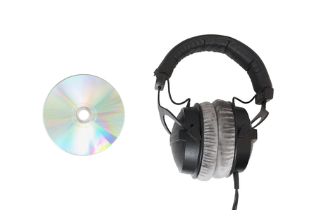 Headphones with multimedia CD  DVD. On white isolated background