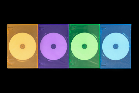 optical disk: Several colored boxes DVD  CD on black background. Top view