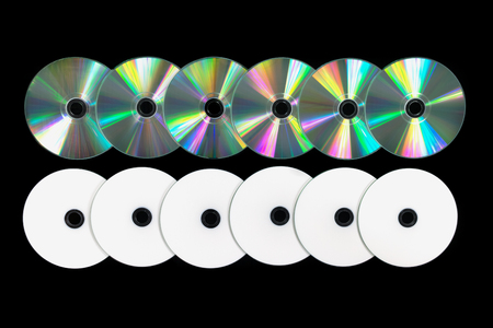 Several DVD  CD on black background. Top view
