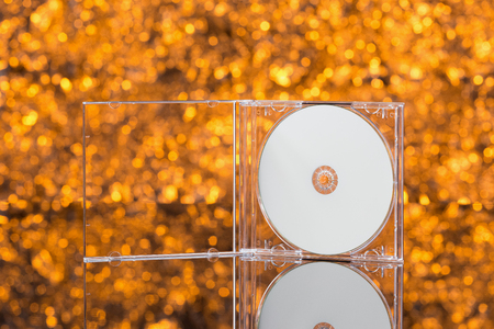 CD  DVD box on orange background. Front view Stock Photo