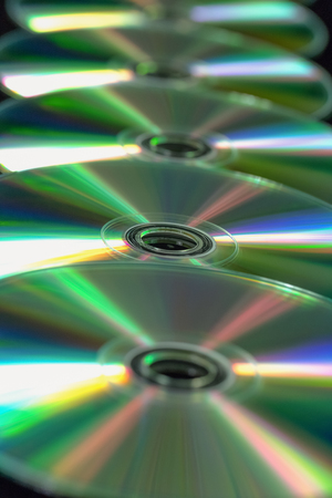 Several CD  DVD in a straight line. Top view
