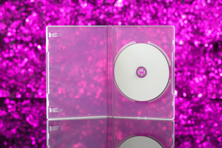 optical disk: CD  DVD box on pink background. Front view