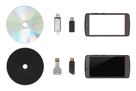 CD, USB flash drive, mobile on white isolated background. Top view Stock Photo
