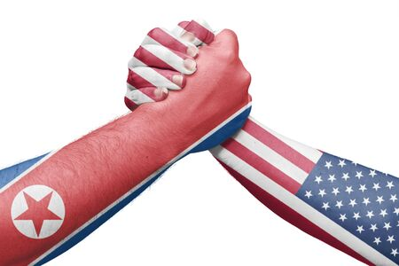 Flags of North Korea and the United States throwing a wrestling arm. Isolated white background Stock Photo