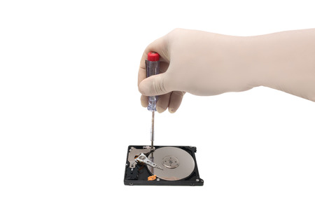 HDD. Repairing open hard drive by hand. Isolated white background
