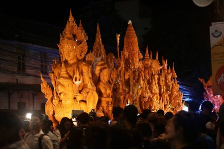 orenge: Ubon Ratchathani.Thailand-30 July 2015:The Ubon Ratchathani Candle Festival, the most elaborate of the traditional parading of candles to wats is held in Ubon Ratchathani, Isan, Thailand, around the days of Asanha Puja