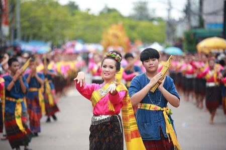 Ubon Ratchathani.Thailand-30 July 2015:Thai dancing girl in Ubon Ratchathani Candle Festival, the most elaborate of the traditional parading of candles to wats  is held in Ubon Ratchathani, Isan, Thailand