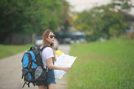 Tourist looking for a way on map in unknown city