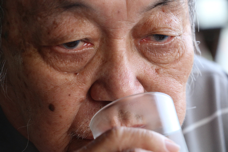 Senior man drinking a glass of water