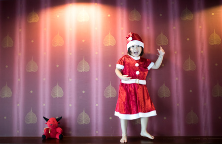 Santa kid dances with happiness on christmas celebration