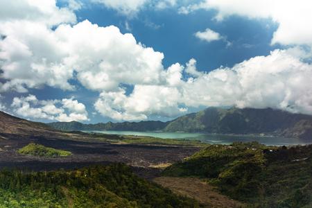 Beautiful cloudscape and landscape of lakeside and lava plain near Kintamani volcano