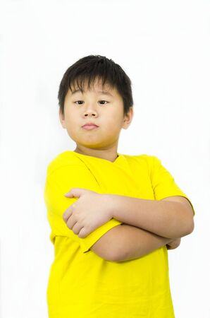 a confident boy with arms crossed Stock Photo
