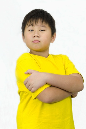 a confident boy with arms crossed photo