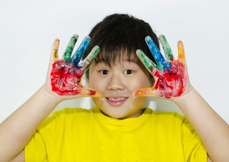child painting with his hands photo