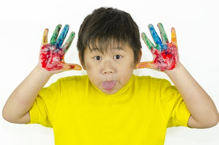 a child paints with his hands and do a funny face photo