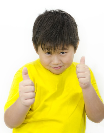 a chinese boy with his thumb up over white background photo