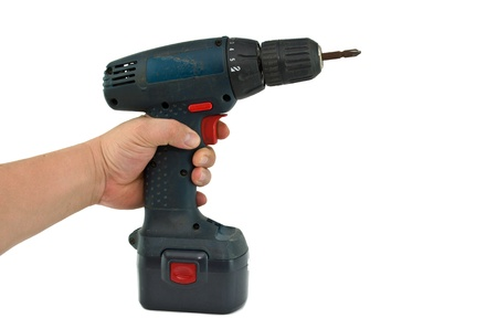 a hand holding a cordless drill with a cross head screw driver tip