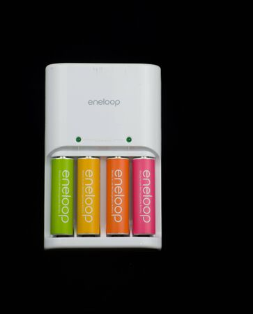 colorful rechargable batteries on a white charger
