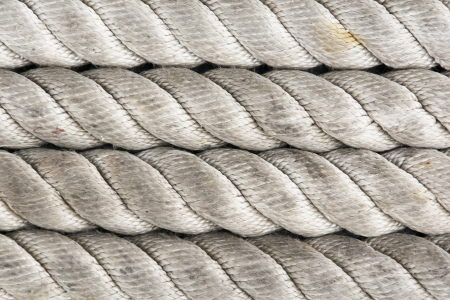 close up of large nylon ropes on a ship