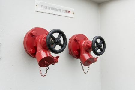 2 fire hydrant points side by side Stock Photo