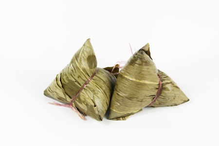 traditional glutonius rice dumpling wrap in leaves photo
