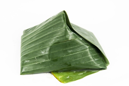 coconut rice  nasi lemak  with sambal chilli wrap in banana leaves Stock Photo