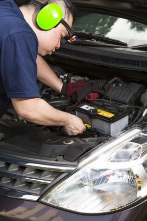 A car mechanic inspecting the car battery   Stock Photo