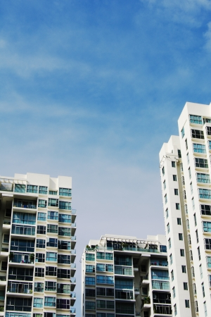 high rise apartments with clear blue sky