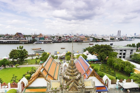 Wat arun Temple with Bangkok city scape as background