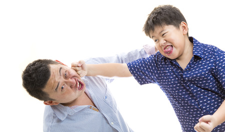 Father and son playing and punching each other on white isolated background