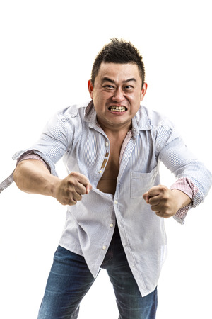 A muscular Asian man flexing his muscle in office attire. Isolated in white  Stock Photo