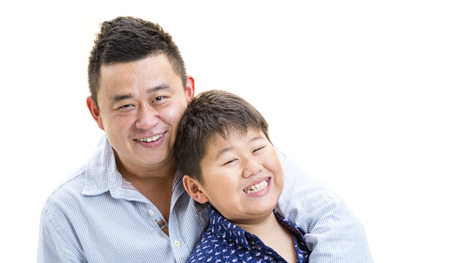 A father holding son for a portray shot on a isolated white background. Stock Photo