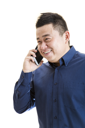 A 34 view of a Asian office worker on phone with white isolated background.