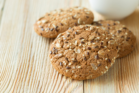 carbohydrates: Few oatmeal cookies with seeds on a wooden table. Stock Photo