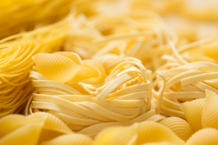 close up: Tagliatelle Pasta. Uncooked macaroni Abstract background