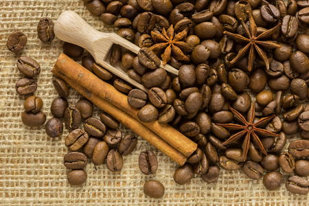 coffee beans, spices and cinnamon star anise burlap background