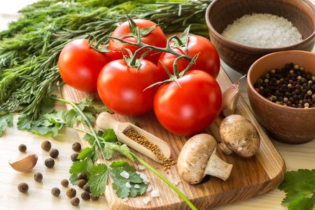 multiple: Ingredients for cooking sauce. Sprig of tomatoes, parsley, garlic, mushrooms, pepper pots, mustard seeds.