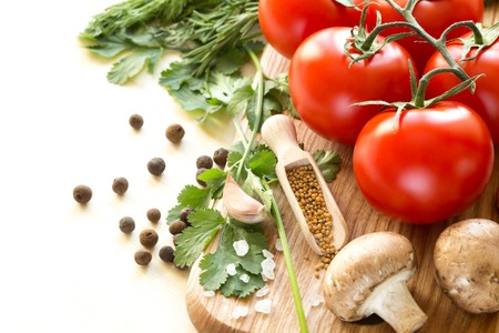 Ingredients for cooking sauce. Sprig of tomatoes, parsley, garlic, mushrooms, pepper pots mustard seeds