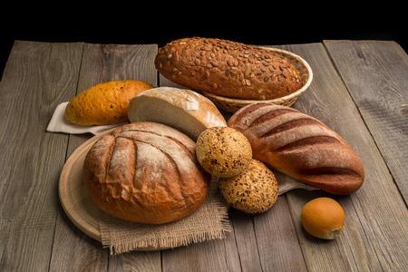 Fresh fragrant bread on a dark wooden table.